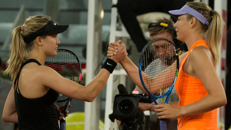 Понедельник. Мадрид. Эжени БУШАР (слева) пожимает руку Марии ШАРАПОВОЙ после победы над ней во втором круге мадридского турнира. Фото REUTERS