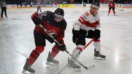 13 мая. Париж. Канада - Швейцария - 2:3 ОТ. Крис ЛИ (слева) против Дамьена БРЮННЕРА.