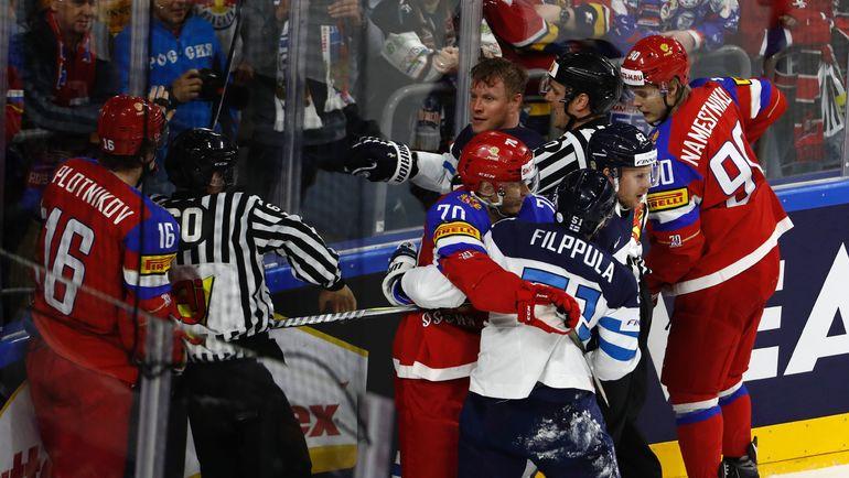 Сегодня. Кельн. Россия - Финляндия - 5:3. Одна из потасовок в матче за бронзу. Фото AFP