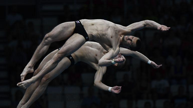 Россиянин Виктор МИНИБАЕВ не считает идею исключить из синхронных прыжков обязательные реальной. Фото REUTERS