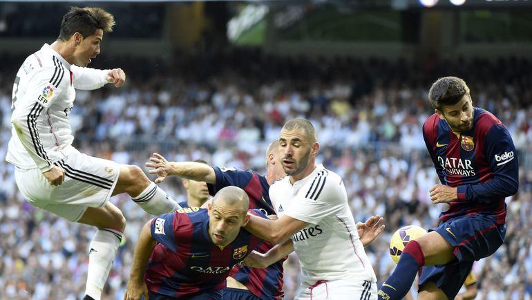 Ответная встреча ведущих клубов испанского чемпионата состоится только в мае. Фото AFP