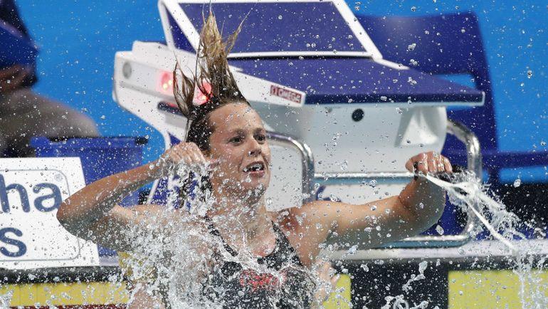Федерика ПЕЛЛЕГРИНИ празднует победу на 200-метровке вольным стилем. Фото AFP