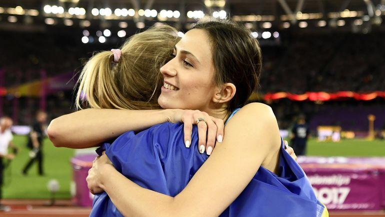 Юлия ЛЕВЧЕНКО (слева), ставшая второй, и Мария ЛАСИЦКЕНЕ. Фото REUTERS