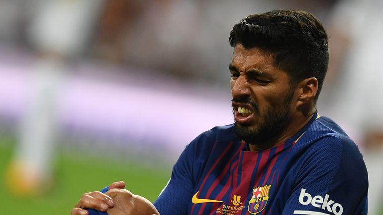 """Среда. Мадрид. """"Реал"""" - """"Барселона"""" - 2:0. ЛУИС СУАРЕС заканчивал матч с травмой колена. Фото AFP"""