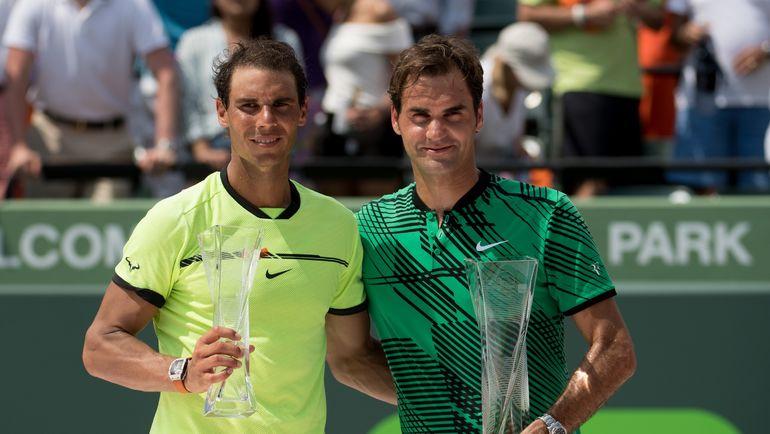Рафаэль НАДАЛЬ (слева) и Роджер ФЕДЕРЕР. Фото AFP