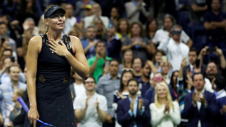Мария ШАРАПОВА празднует победу над Симоной Халеп. Фото REUTERS