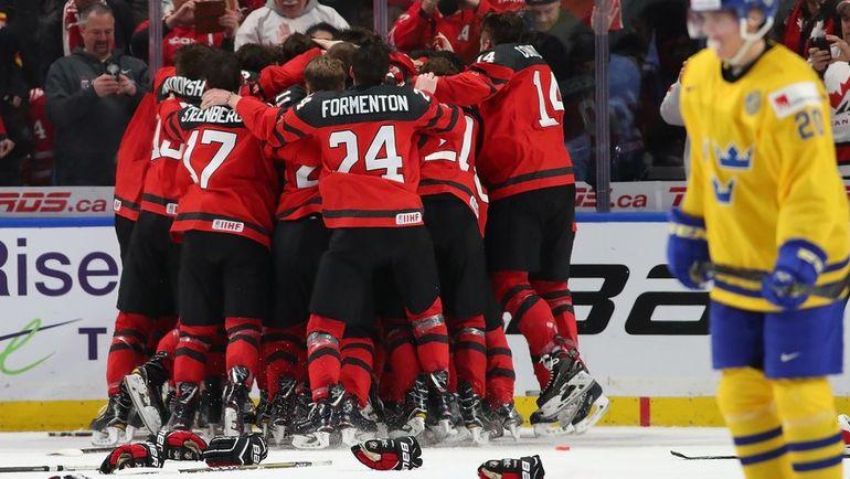 Игроки сборной Канады празднует победу на МЧМ-2018. Фото AFP