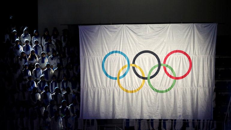 Олимпийский флаг на арене Игр. Фото REUTERS