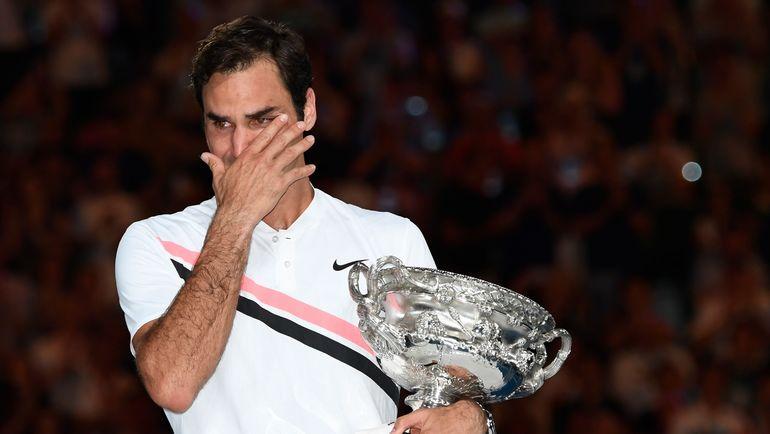 """Сегодня. Мельбурн. Роджер ФЕДЕРЕР выиграл свой шестой титул в Австралии и 20-й на турнирах """"Большого шлема"""". Фото REUTERS"""