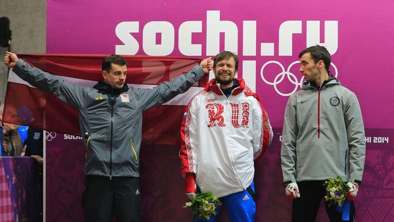 Медалисты Сочи-2014, слева направо - Мартин ДУКУРС (серебро), Александр ТРЕТЬЯКОВ (золото) и Мэттью АНТУАН (бронза). Фото AFP