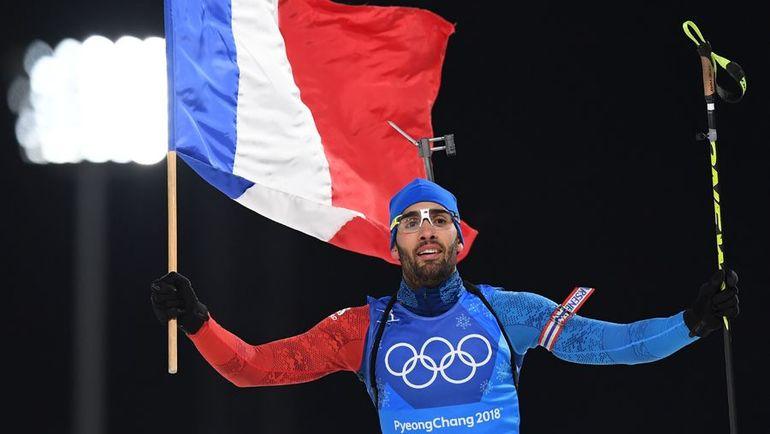 Сегодня. Пхенчхан. Мартен ФУРКАД финиширует с французским флагом в смешанной эстафете на Олимпийских играх. Фото AFP