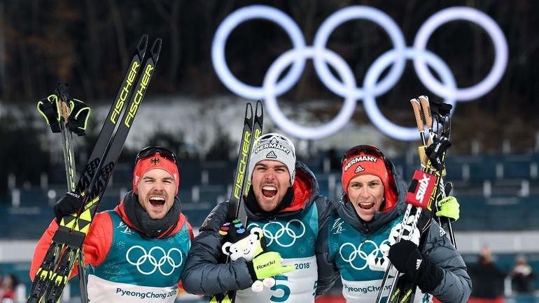 Немцы Йоханнес РИДЗЕК, Фабиан РИССЛЕ и Эрик ФРЕНЦЕЛЬ. Фото AFP