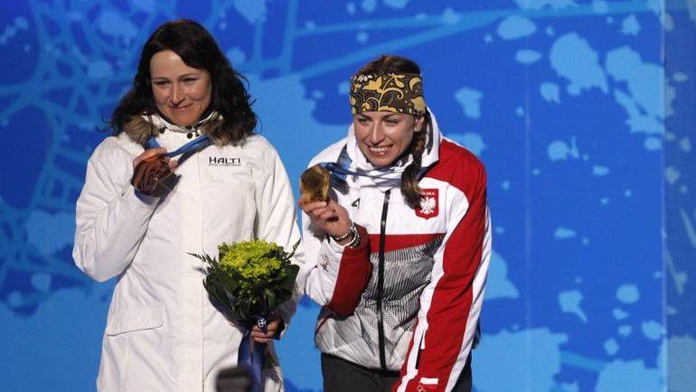 Марит БЬОРГЕН (слева) и Юстина КОВАЛЬЧИК. Фото REUTERS