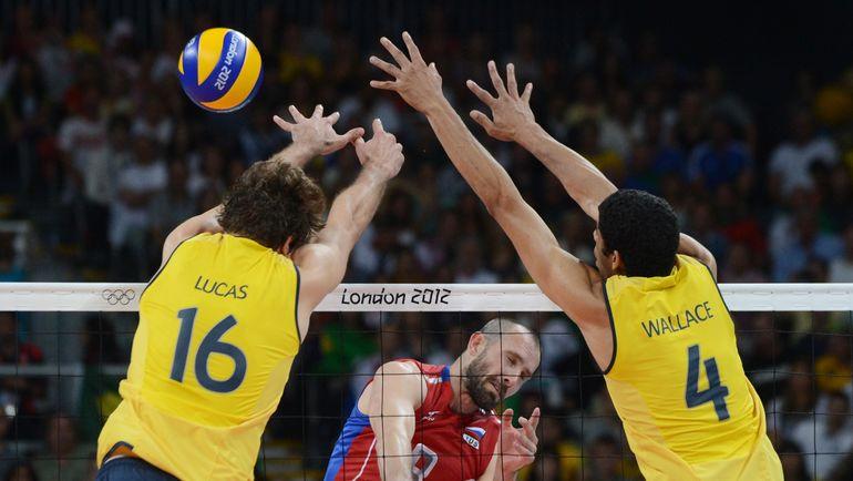 12 августа 2012 года. Лондон. Россия - Бразилия - 3:2. В атаке Сергей ТЕТЮХИН (в центре). Фото AFP