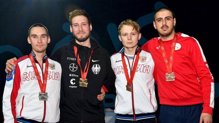 Камиль ИБРАГИМОВ (слева), Макс ХАРТУНГ (второй слева), Дмитрий ДАНИЛЕНКО (второй справа) и Сандро БАЗАДЗЕ. Фото twitter.com/FIE_fencing