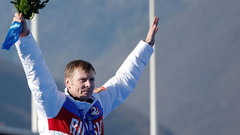 24 февраля 2014 года. Александр Зубков празднует победу в соревнованиях четверок на Олимпийских играх в Сочи. Фото REUTERS