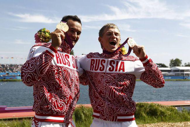 Суббота. Лондон. Александр ДЬЯЧЕНКО (слева) и Юрий ПОСТРИГАЙ - олимпийские чемпионы! Фото REUTERS