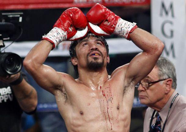 Звезде профессионального бокса Мэнни ПАКИАО  не суждено стать героем Олимпиады. Фото AFP