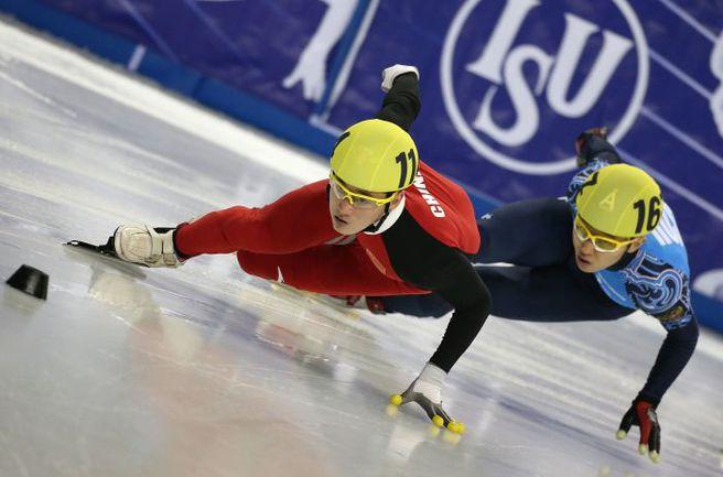 Шестикратный олимпийский чемпион Виктор АН (справа) - в погоне за очередным титулом. Фото AFP