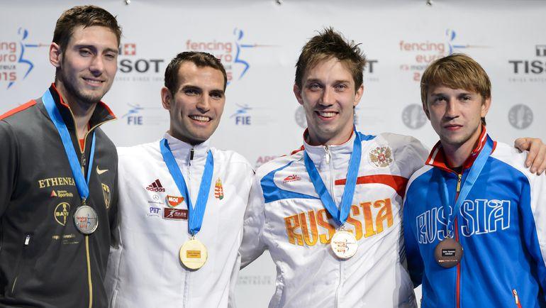 Алексей ЯКИМЕНКО и Николай КОВАЛЕВ (крайние справа) - бронзовые призеры чемпионата Европы-2015. Фото AFP