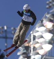 Алла ЦУПЕР выполняет свой прыжок в соревнованиях по акробатике. Фото REUTERS
