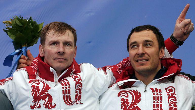 Александр ЗУБКОВ и Алексей ВОЕВОДА. Фото REUTERS