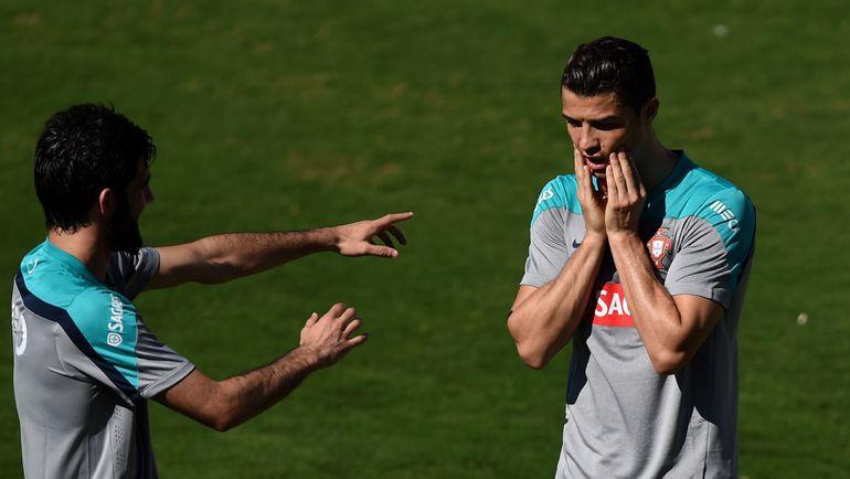 2014 год. Луиш НЕТУ (слева) и КРИШТИАНУ РОНАЛДУ на тренировке сборной Португалии. Фото AFP