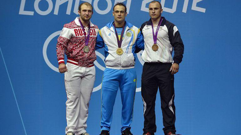 Вся тройка призеров Игр-2012 в Лондоне в весовой категории до 94 кг по итогам перепроверки проб была уличена в приминении допинга. Фото REUTERS