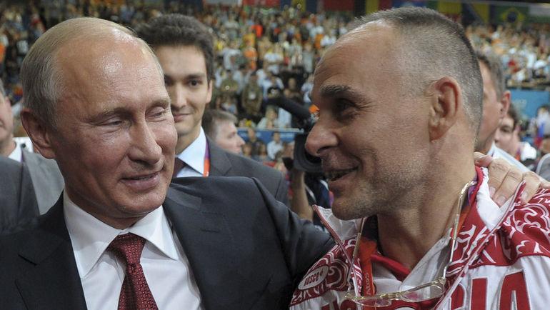 Эцио ГАМБА и Владимир ПУТИН. Фото REUTERS