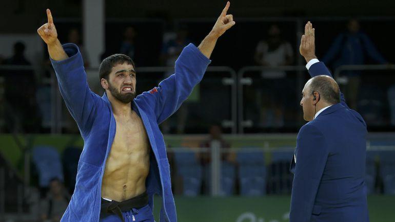 Хасан ХАЛМУРЗАЕВ - чемпион! Фото REUTERS