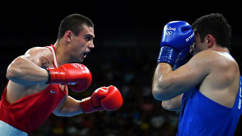 Сегодня. Рио-де-Жанейро. Евгений ТИЩЕНКО (слева) против Рустама ТУЛАГАНОВА. Фото AFP