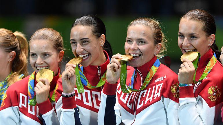 Сегодня. Рио-де-Жанейро. Кадр дня: Софья ВЕЛИКАЯ (справа) с олимпийским золотом. Наконец-то! Фото AFP