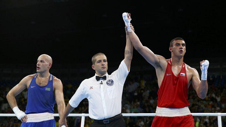 Евгений ТИЩЕНКО (справа) до последнего не понимал, кого объявят победителем. Фото REUTERS