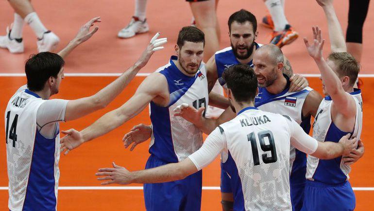 Игроки сборнной России празднуют победу. Фото AFP