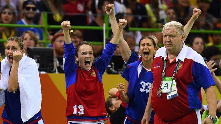 Евгений ТРЕФИЛОВ (справа) и его команда. Фото AFP