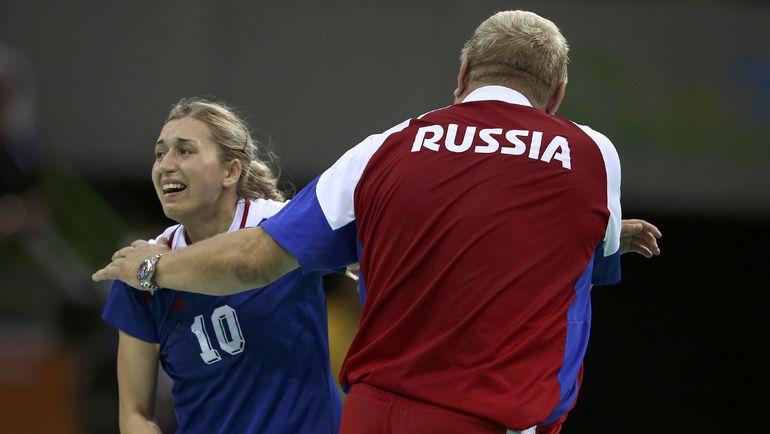 Евгений ТРЕФИЛОВ (справа) и Ольга АКОПЯН. Фото REUTERS