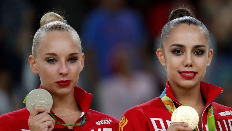Маргарита МАМУН (справа) и Яна КУДРЯВЦЕВА. Фото AFP