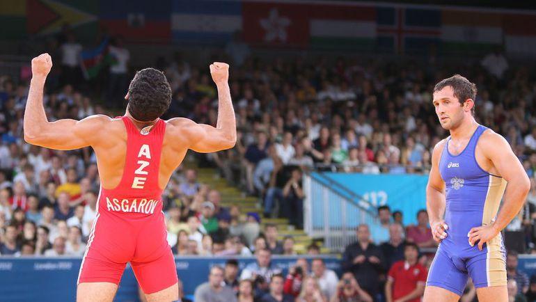 11 августа 2012 года. Лондон. Бесик КУДУХОВ (справа) проигрывает финал Олимпиады. Фото AFP