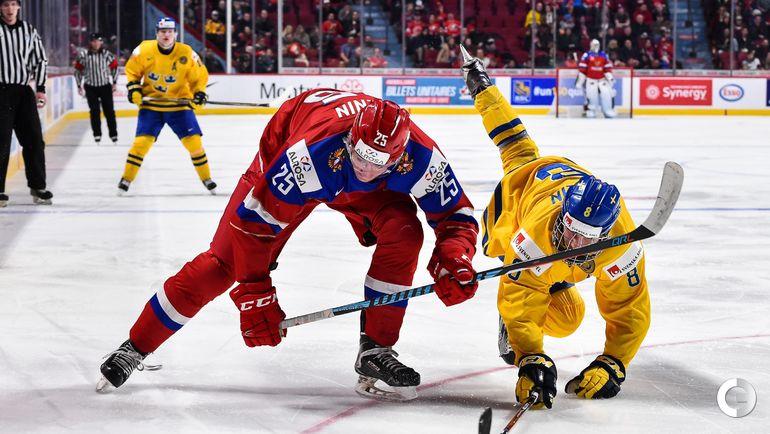 Сегодня. Монреаль. Швеция - Россия - 1:2 ОТ. Яков ТРЕНИН (слева) и Расмус ДАЛИН. Фото AFP
