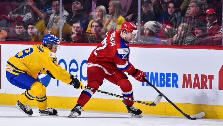 Сегодня. Монреаль. Швеция - Россия - 1:2 ОТ. Даниил ЮРТАЙКИН (справа) и Тим СЕДЕРЛУНД. Фото AFP