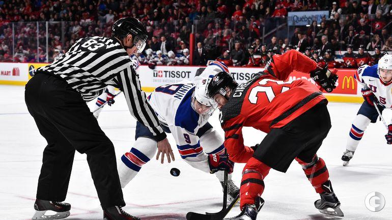 Четверг. Монреаль. США - Канада - 5:4 Б. Люк КАНИН (в центре) и Энтони ЧИРЕЛЛИ на точке для вбрасывания. Фото AFP