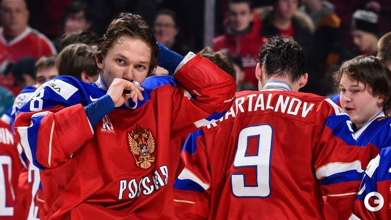 Сегодня. Монреаль. Швеция - Россия - 1:2 ОТ. Кирилл УРАКОВ с медалью. Фото AFP