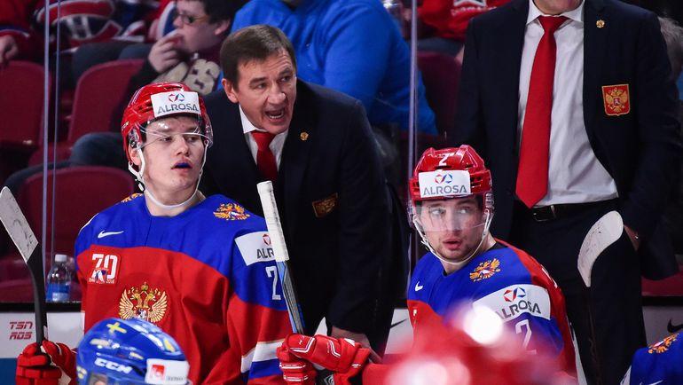 Валерий БРАГИН со своими хоккеистами. Фото AFP