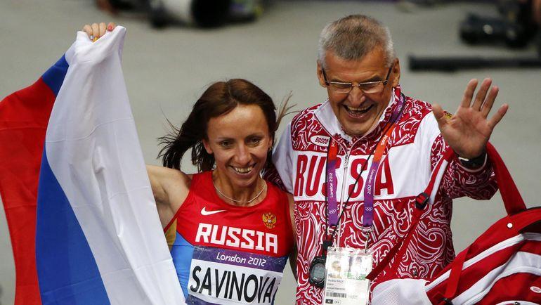 11 августа 2012 года. Лондон. Владимир КАЗАРИН и олимпийская чемпионка в беге на 800 м Мария САВИНОВА. Фото AFP