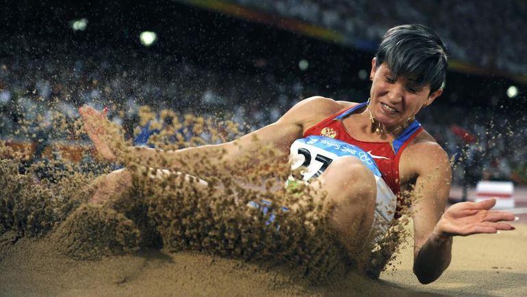 22 августа 2008 года. Пекин. Татьяна ЛЕБЕДЕВА: серебряный призер Игр-2008 в прыжке в длину и в тройном прыжке. Фото REUTERS
