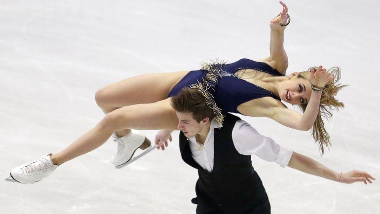 Виктория СИНИЦИНА и Никита КАЦАЛАПОВ. Фото REUTERS