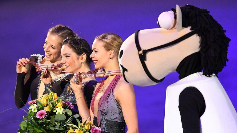 Каролина КОСТНЕР, Евгения МЕДВЕДЕВА и Анна ПОГОРИЛАЯ (слева направо). Фото AFP