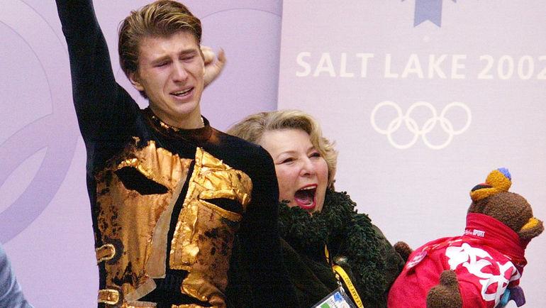 14 февраля 2002 года. Солт-Лейк-Сити. Татьяна ТАРАСОВА и Алексей ЯГУДИН празднуют победу на Олимпийских играх-2002. Фото REUTERS