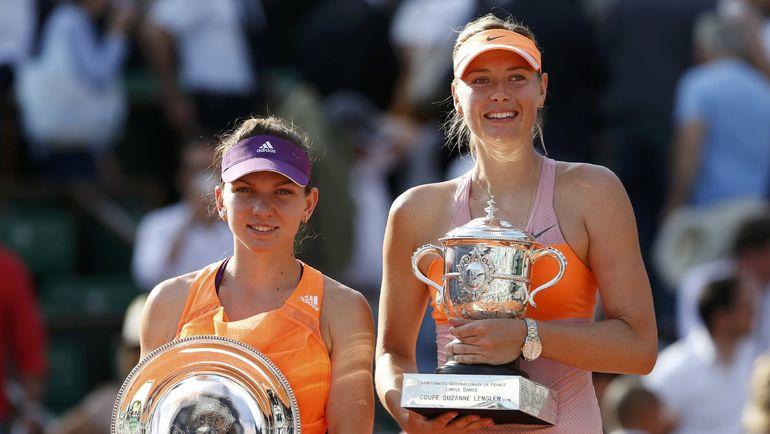 7 июня 2014 года. Париж. Мария ШАРАПОВА (справа) и Симона ХАЛЕП после финала Roland Garros, завершившегося победой россиянки. Фото AFP