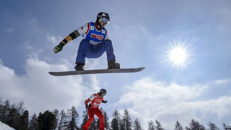 Николай ОЛЮНИН (в синем). Фото AFP